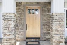 Wood Front Door Of A Home. View Of A Rustic Front Door In Modern