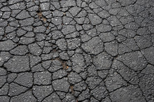 Cracked Asphalt Road Surface Background