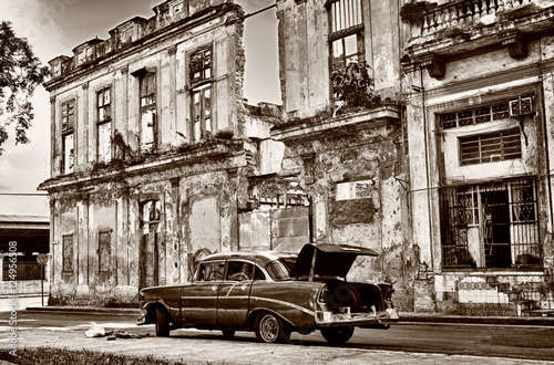 Sepia toned image of old classic car on Havana street Canvas Print