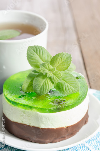 Spoed Foto op Canvas koffiebar herbal tea with cake on wooden background.