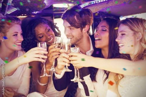 Composite image of happy friends toasting champagne