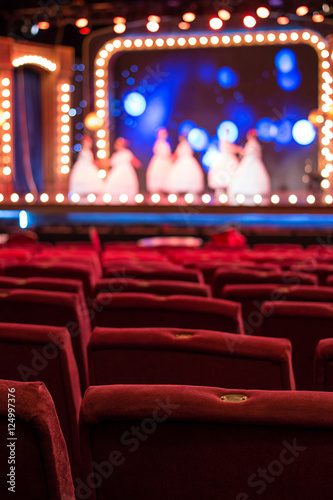 Performance Hall with Empty Red Chairs