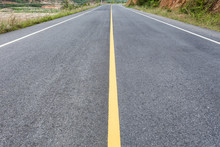 Asphalt Road  With Yellow Line.