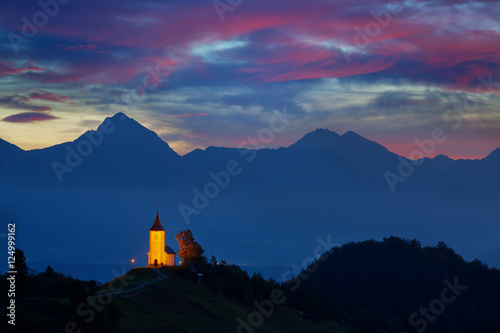 Fototapeta St. Primoz church in Yamnik at sunrise, Slovenia