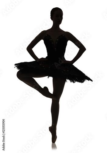 Fotografija Ballerina silhouette making ballet position pirouette against white background,