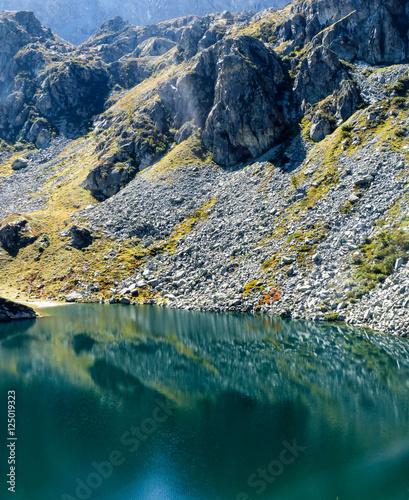 Poster Reflexion Le cime rocciose attorno alla catena del Monviso riflesse nelle limpide acque del Lago Fiorenza in autunno Cuneo Piemonte Italia