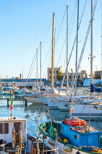 Foto op Aluminium Cyprus Sea bay with yachts and boats at sunset. Mooring for boats in San Remo, Italy.