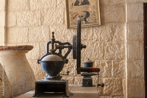 Photo  vintage grain mill in St George Orthodox Monastery, located in W