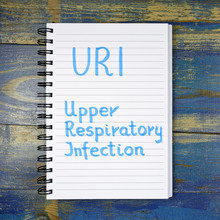 URI- Upper Respiratory Infection Acronym Written In Notebook On Wooden Background