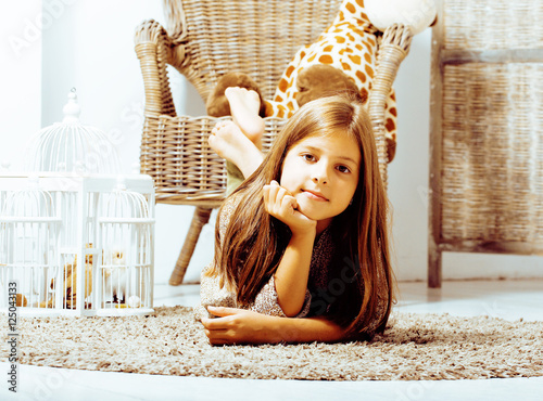 Poster  little cute brunette girl at home interior happy smiling close u