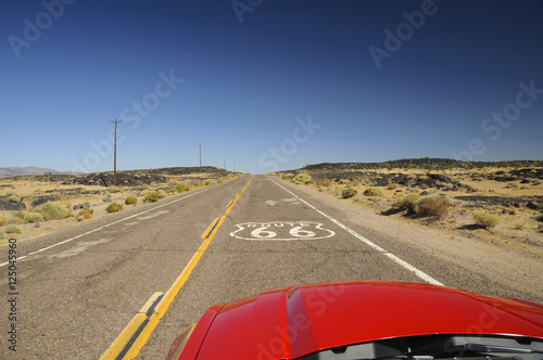 Poster Route 66 view from red car on famous Route 66 in Californian desert, USA