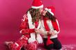 Leinwandbild Motiv Two girls are wearing winter clothes in studio
