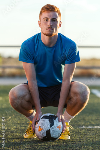 Sitting football player