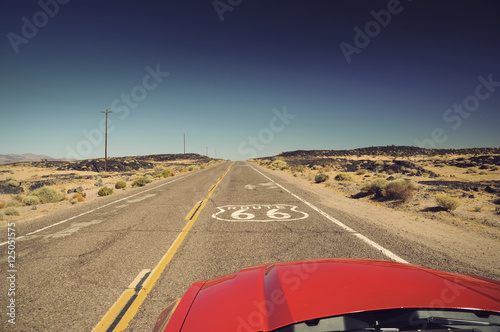 Fotobehang Route 66 view from red car on famous Route 66 in Californian desert, USA, Vintage filtered style