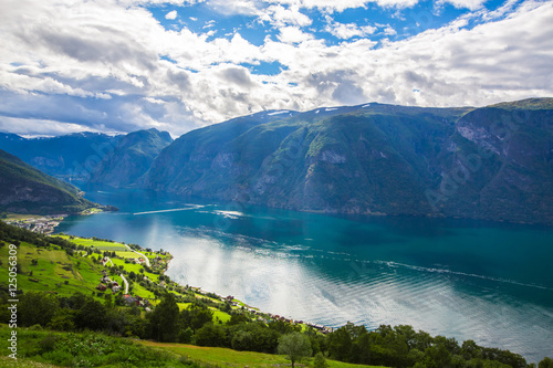 In de dag Noord Europa View to Sognefjord in Norway. Small town and cruise port Olden in Norwegian fjords. Bird view of fjord in Norway. under a sunny, blue sky, with the typical rorbu houses. View from the top