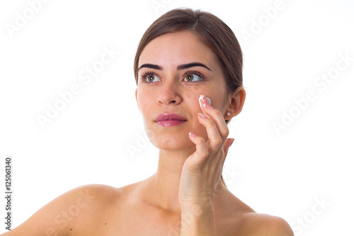 Fototapety, obrazy: Young woman using cream