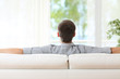 Man relaxing on a couch at home