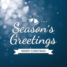 Season Greetings With Blue Bokeh Defocused Background
