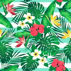 Tropical flowers and palm leaves on turquoise stripes background. Seamless. Vector pattern.