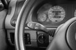 close up shot of a car's simple turn signal lever. black and white image. low key
