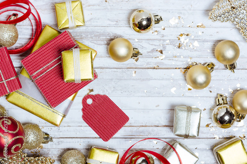 Golden christmas decoration with gifts the wood table. New years ...