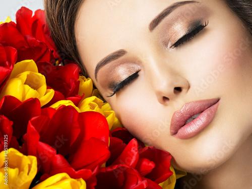 Closeup beauty  face of the young woman with flowers. Slika na platnu