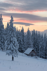 Fototapeta Zima Winter landscape with wooden house in the mountains