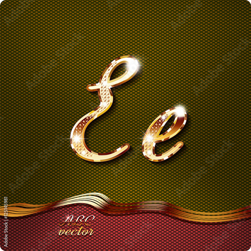 this stylish gold cursive letters there are inlaid with a capital