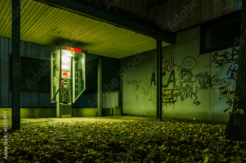 Fototapeta Scary Creepy Green Atmosphere Alone Empty Payphone Ghetto Graffi obraz