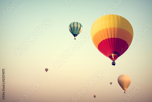 Deurstickers Ballon Hot air balloon on sky with fog, vintage and retro instagram filter effect style