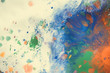 Multicolored paint stains, drips, splashes, mixing. Abstract background