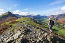 A Woman Walking Up To Cat Bells, A Peak In The Derwent Fells Near Keswick In The English Lake District