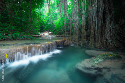 Fototapety, obrazy: Jangle landscape with flowing turquoise water of Erawan cascade waterfall at deep tropical rain forest. National Park Kanchanaburi, Thailand
