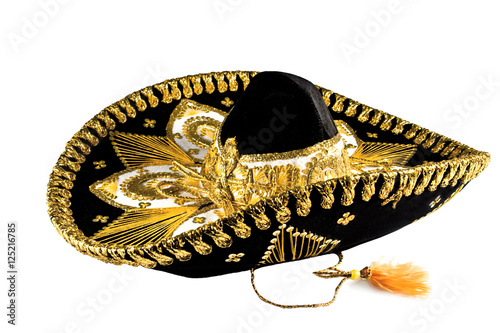 Fotografie, Obraz  Black with gold ornate trim Mexican hat, sombrero isolated on white background