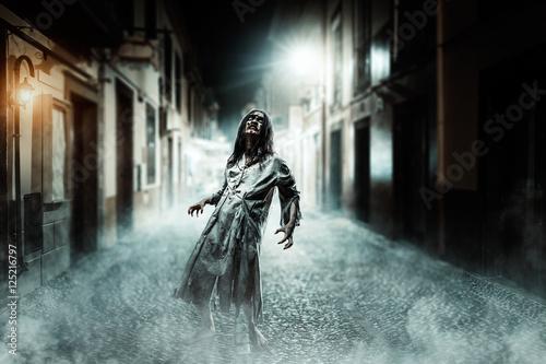 Horror zombie on the street. Halloween. Canvas Print