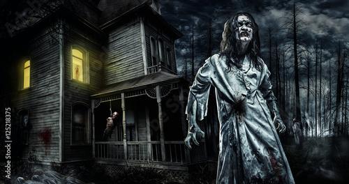 Horror zombie near the abandoned house. Halloween. Wallpaper Mural