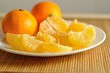 The slices of tangerines on plate