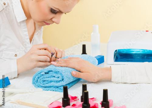Fotografie, Obraz  Female beautician making nails.
