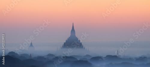 Photo  Amazing misty sunrise colors and silhouette of ancient Myauk Guni Pagoda
