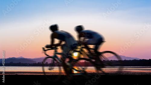 Foto op Plexiglas Fietsen Cycling at beach on twilight