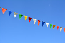 Pennant Flags And Blue Sky