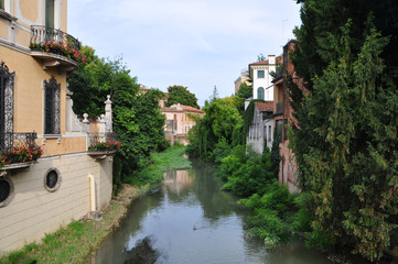 Fototapeta na wymiar city canal in the centre of the old city Padua, Veneto, Italy