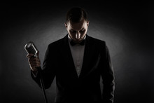 Silhouette Of Young Handsome Singer On Black Background. Singer Concept.
