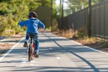 Kid Riding His Bicycle On Bike...