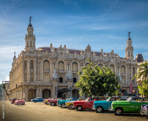 Photo Stands Havana Cuban colorful vintage cars in front of the Gran Teatro - Havana