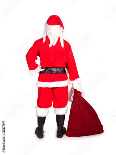 nikolaus weihnachtsmann mit sack von hinten stockfoto