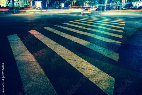 Nights lights of the big city, the night avenue with road markings and headlight Canvas-taulu