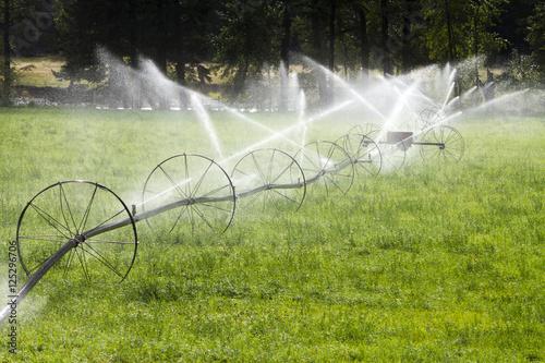 Fotobehang Tuin Irrigation Wheel Line Sprinkler Agricultural Equipment