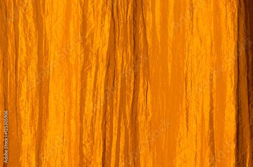 Fotografia, Obraz  Orange curtain made of crinkled satin