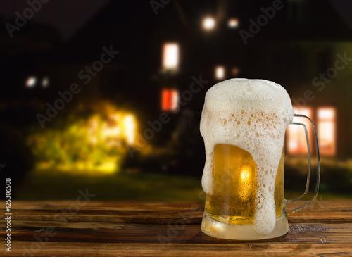 Photo sur Toile Biere, Cidre cold mug of beer in a landscape